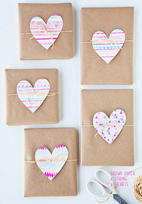 Great idea! Plain brown paper to wrap, then use themed paper to embellish and tie with string