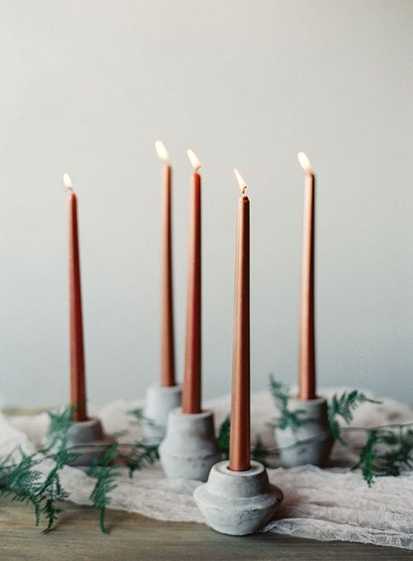 Slim Mocha Taper Candles in Marble Holders | Lauren Peele Photography | http://heyweddinglady.com/rich-romantic-garnet-mocha-wedding-valentines-day/