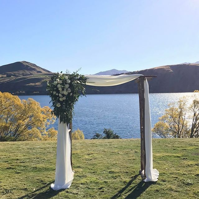 Our large wooden arch looking beautiful at a lakeside ceremony!