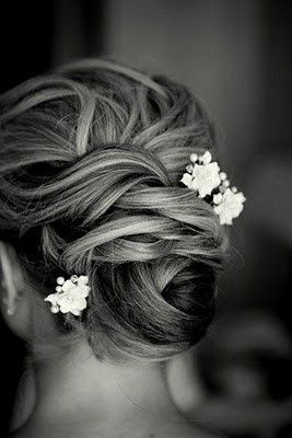 Wedding hair. bun with flower.  Bun.   Wedding hair with flowers flower accents hair accessories
