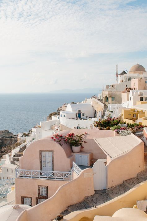 Santorini, Greece has such a beautiful ocean and the building are such a freaking beautiful color