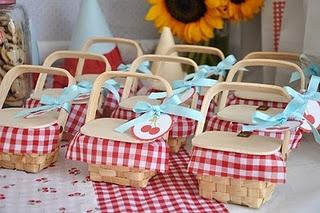 Picnic baskets...everyone has there own and also makes a great favor for your guests! What a great idea for an outdoor get together. (sweet red gingham)