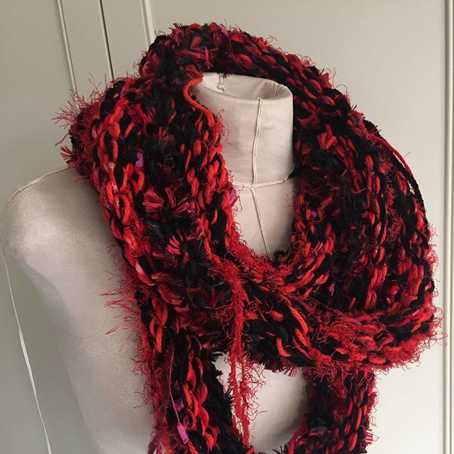 This Loop in passionate reds and blacks with just a hint of purple and orange turned out too long for the client who commissioned it.  She asked for it to be soft and cosy with no wool to bother her sensitive skin. The hanging tails give an idea of the many cotton and synthetic fibres used in its construction.  Now available for sale on my Facebook page.