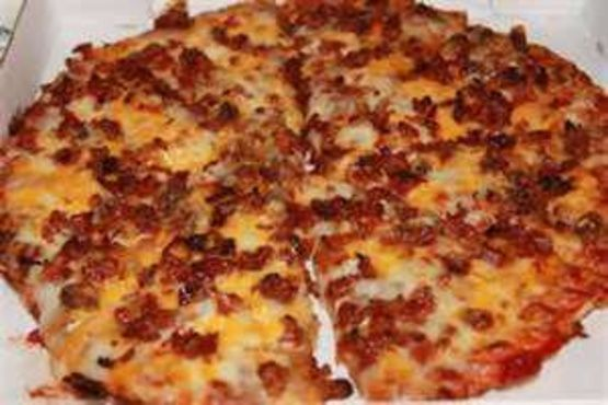 The secret to this delicious pizza is to pre-bake your crust firstly and brown your beef well, then top as stated in directions and bake just to heat through and until the cheese has melted. This is a hearty pizza that can be made using store-bought refrigerated pizza dough or homemade, just make certain to pre-bake the crust before topping. This can also be made using a store-bought Boboli pizza crust. The success of this recipe will also depend on your pizza sauce, I use my recipe#65641 it…