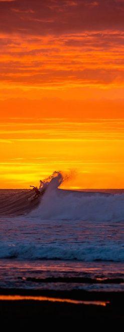 Jordy Smith surfs the spectacular sunset at Bells Beach. http://win.gs/1lPse9X Image: Trevor Moran #bellsbeach #jordysmith