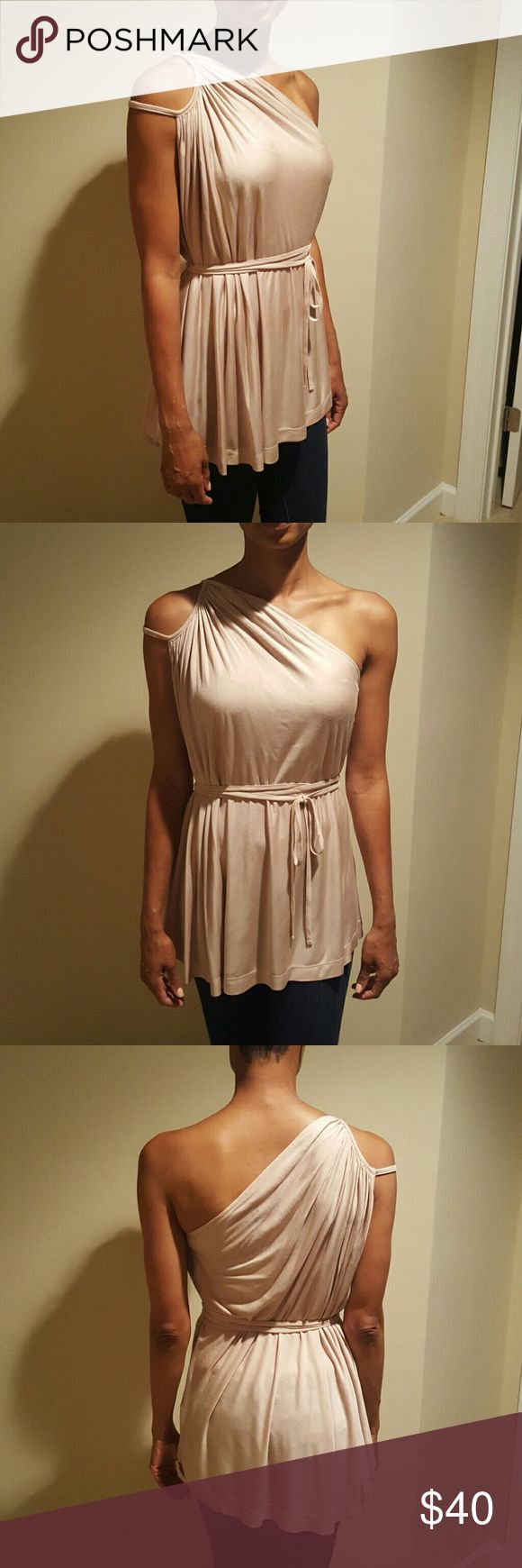 French Connection Grecian Blouse Beautiful grecian-style blouse with tie waist. On trend blush-color and one shoulder style. 100% Rayon. French Connection Tops