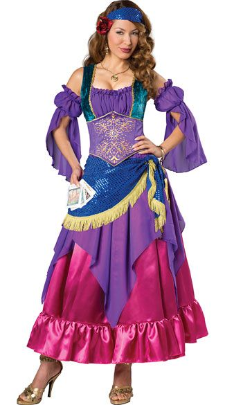 Predict the future in this Gypsy Treasure costume featuring a long dress with ruffled purple cups, draping detached sleeves, blue shoulder straps with a gold trim, a purple embroidered waist, a blue sequin waist sash with a gold fringe trim, a sheer purple overlay, a pink skirt with a ruffled hem, and a matching sequin headband with a floral accent. (Tarot cards not included.) Gypsy Treasure Costume, Sexy Gypsy Costume, Colorful Gypsy Costume