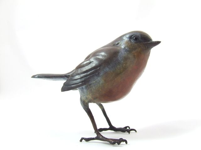 Steve Langford - Robin (Solid bronze sculpture) The Robin was formerly classed as a member of the thrush family (Turdidae), but is now considered to be an Old World flycatcher (Muscicapidae). Dimensions: 3x4x2 inches Weight: 220g