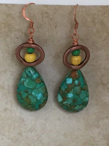 Exotic Mosaic Turquoise Earrings the perfect addition to your boho look. Tear shaped beads with coppertone hoops that have wooden yellow and green beads. Copper Ear wires.