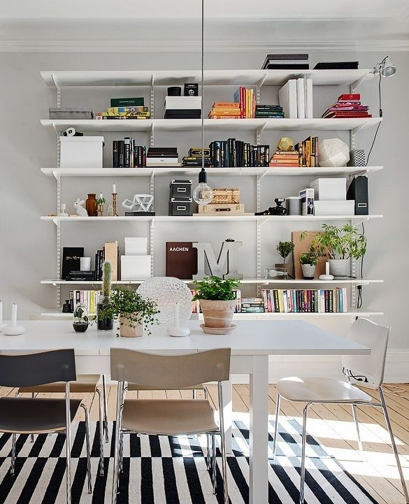 Love the look of these wall hung shelves! Photo from a Scandinavian styled Gothenburg apartment. Wondering if this might work as a media/TV solution..