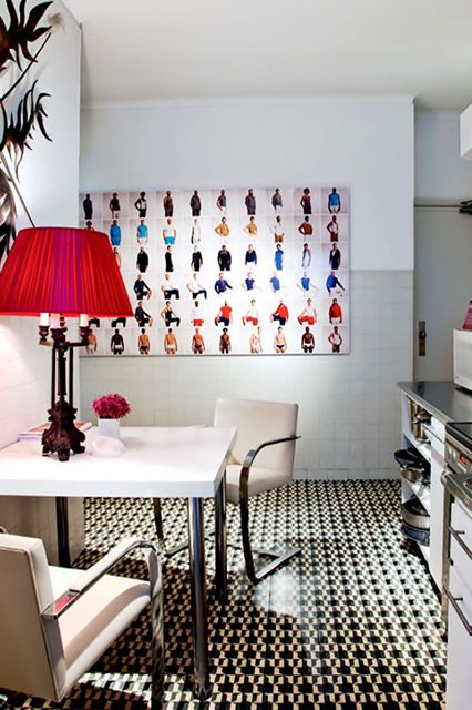 12 Inspiring Ways To Hang Art In Your Kitchen #refinery29  http://www.refinery29.com/design-milk/17#slide4  This is the kitchen of a bold apartment in Porto, Portugal owned by the design duo behind Oitoemponto Architecture