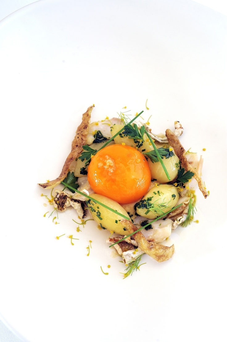 Egg yolk and new potatoes, salt cod and fish crackling. Photo by Terence Carter