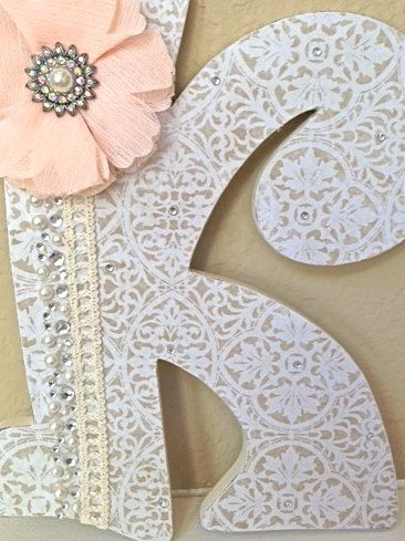 Custom Wooden Nursery Letters  Baby Girl Nursery by TheRuggedPearl, $16.50. Could easily DIY by spray painting over lace and then hot gluing embellishments.