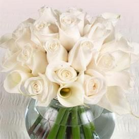 another calla lily rose centerpiece: White roses with orange calla lilies would be beautiful