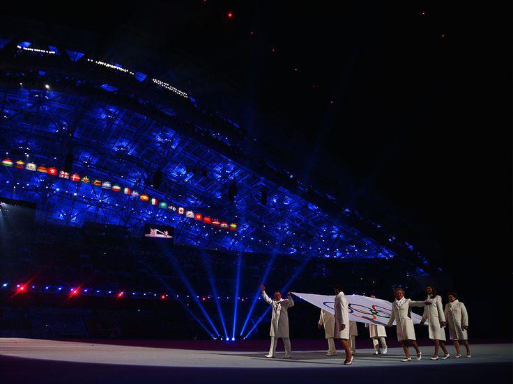 Sochi 2014 - Opening Ceremony - Olympic flag bearers Chulpan Khamatova, Lidiya Skoblikova, Anastasia Popova, Valentina Tereshkova, Vyacheslav Fetisov, Valeriy Gergiev, Alan Enileev and Nikita Mikhalkov carry the Olympic flag.