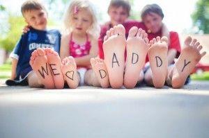 "We <3 daddy"" written on their feet"