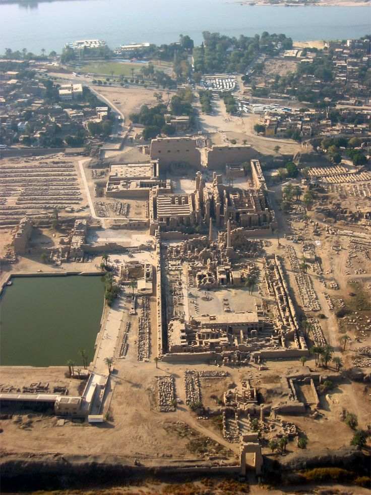 Karnak Temple (partial view), the largest temple site in the world, the sacred lake used by the priests for daily ritual is on the left.