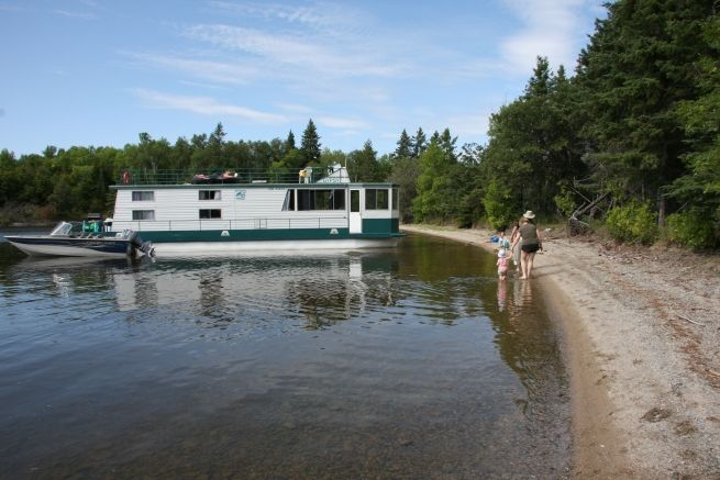 Moor on different beach each night? Absolutely. Houseboating on Lake of the Woods. Sioux Narrows, Ontario, Canada