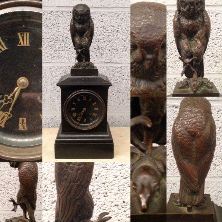 pendule borne en granit noir,hibouen bronze patiné à l amortissement. XX siècle