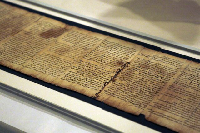 Trace the Complete History of the Bible: Israel Museum in Jerusalem displays part of the Isaiah Scroll, one of the Dead Sea Scrolls.