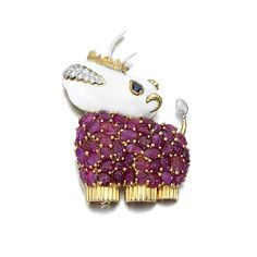 WHITE ENAMEL, SAPPHIRE, RUBY AND DIAMOND BROOCH, DAVID WEBB Designed as a rhinoceros, the white enamelled head decorated with a pear-shaped sapphire eye and brilliant-cut diamond set mouth, the body with carved rubies, mounted in yellow gold and platinum, signed David Webb.