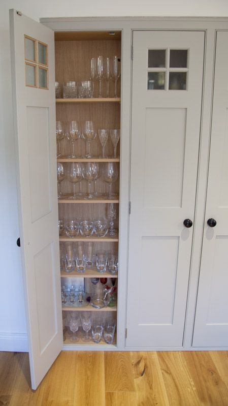 A wine glass cupboard, handmade and painted by www.dunhamfittedfurniture.co.uk in Farrow and Ball Pavilion Grey