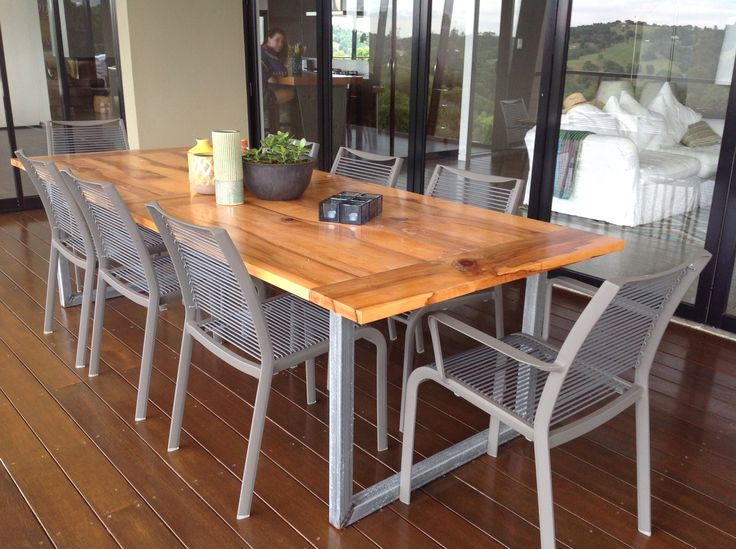 Outdoor dining table built using a combination of steel legs and timber top.