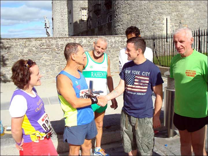 Instructor Brian A receives his medal for running his 100th Marathon...and he did it in less than two years too!