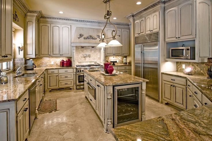 Mediterranean Kitchen with two dishwashers, Custom hood, Delta - 1177lf traditional wall mount pot filler faucet - chrome