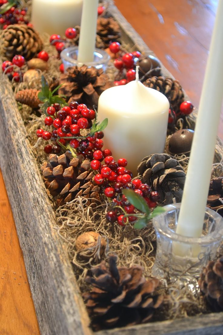 """You remember that box my husband made from an old pallet? Well, I removed the punkin's and added more pine cones, berries, bells, and candles. Now, our table is ready for Christmas! Yay! Sorry about the photo """"overkill""""….I finally got a new camera, and I'm trying to figure out how to run"""