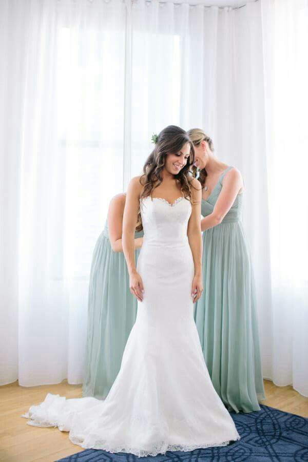 Like this fit and flare gown! Also the mint green bridesmaid dresses!