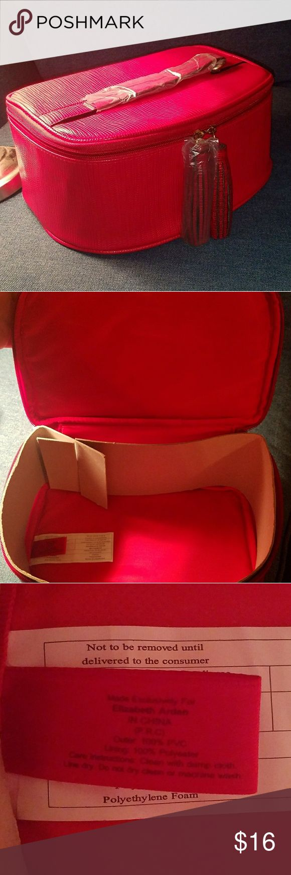 NWOT Elizabeth Arden Red Large Makeup Case Beautiful sassy red case by Elizabeth Arden. Very roomy, perfect to take on a trip to store your beauty essentials. Two zippers with red fringe details on both! Very clean inside and out. Also has a handle on top to make it easy to carry! Elizabeth Arden Makeup