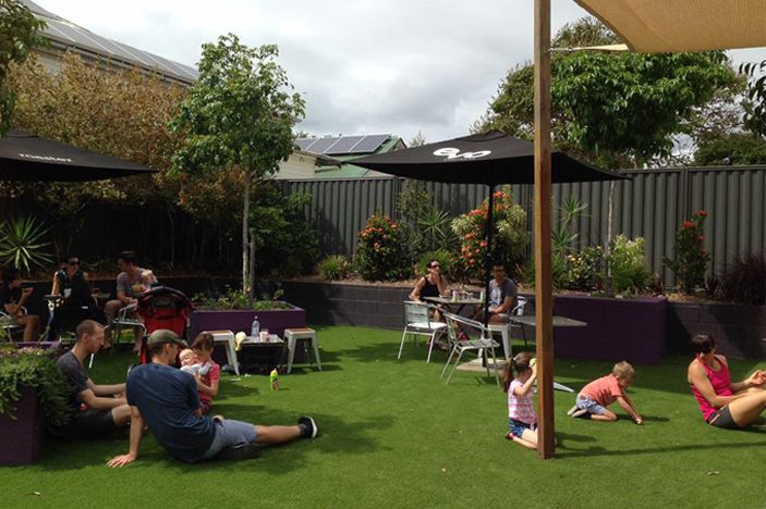 A place to eat with kids in Brisbane with yummy coffee and tables situated in a fenced, outdoor area..