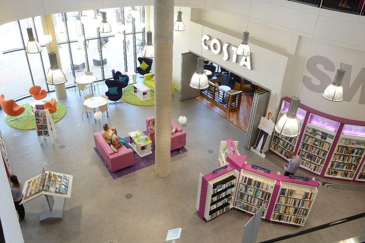 Ground floor - tempting book display alongside stylish seating area and access to coffee shop