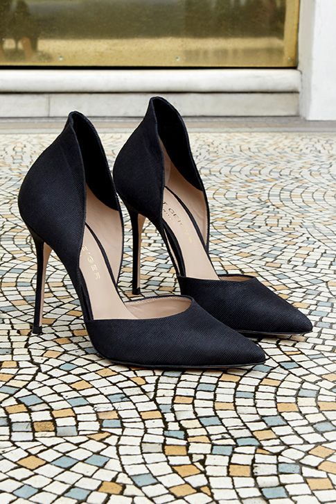 Introducing Strike by Kurt Geiger London. This d'Orsay occasion court comes in exquisite black grosgrain and has a striking high back feature. With a leg-lengthening 105mm heel, it makes a true style statement at special occasions.