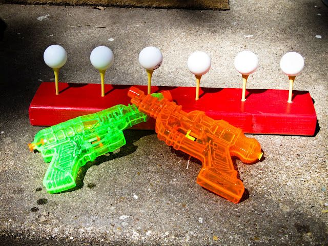 """Spray Away: knock ping-pong ball off a golf tee with spray from a water gun. Would be fun with Nerf guns too. Good hand-eye coordination as well as fine motor skills!! A bb gun would be fun too but of course water is cheaper and you dont have to hear people say """"You'll shoot your eye out!!"""""""