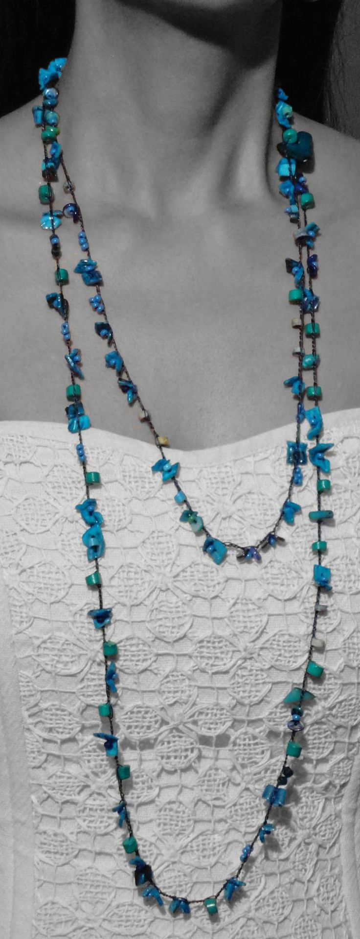 Vivid fancy blue and turquoise ceramic beads harmonized with   Ammandras (a dried seedpod of the  tropical rainforests' Palm-tree – Ammandra Decasperma- which grows in South America), create a simply stunning long necklace.