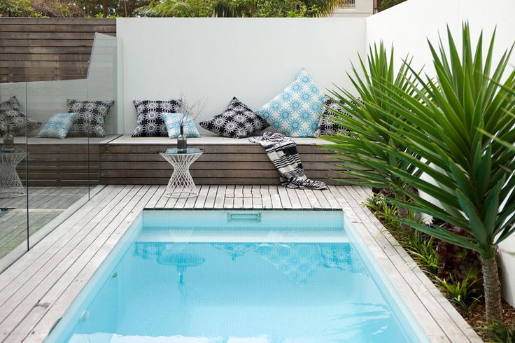 Relax by the lap pool with this deck and built in lounge area