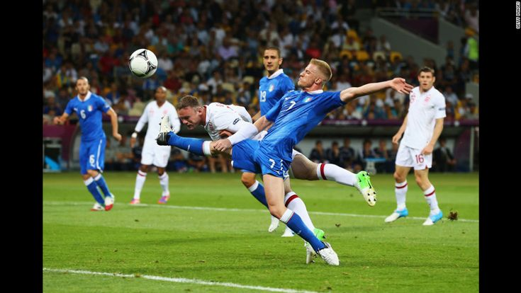 Wayne Rooney of England heads the ball as Ignazio Abate of Italy challenges during the quarterfinal match. CNN.com