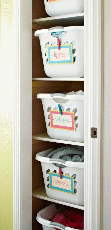 GENERAL HOUSE IDEA: Lovely linens    Labeled hampers mean linens get stored and transported in one container.