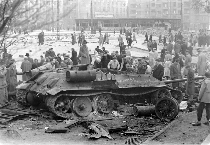 People looking at the wreck of a Soviet tank, Budapest, Hungary, 1956