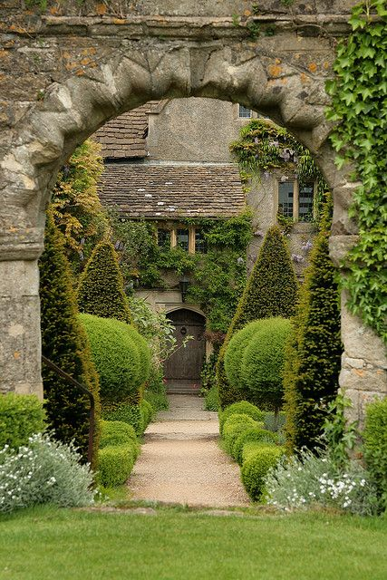 Abbey House Gardens - Malmesbury, Wiltshire, England. Once the site of the Abbot of Malmesbury Abbey's garden, the garden today covers 5 acres, and is located directly beside the historic ruins of the Abbey. The gardens are built about a 16th century house, and offer richly colourful garden walks throught the spring, summer, and fall. (England's oldest town.)