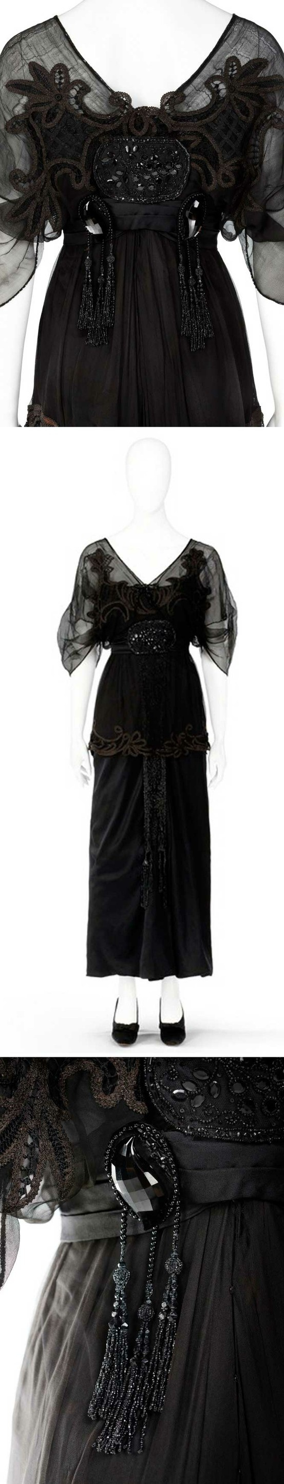 Dress, ca. 1910-14. Black silk and tulle. Bodice with simple kimono cut, v-neck front and back, short sleeves, and embroidery with pearls and sequins. On top of the silks, tulle cut into a loose train, edged with dark brown and black lace. Hallwyl Museum, Sweden