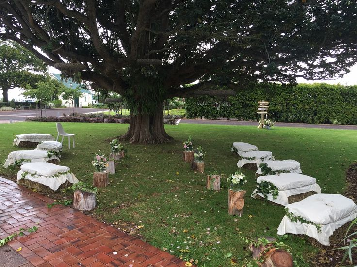 Ceremony under the tree with hay bales for guest seating