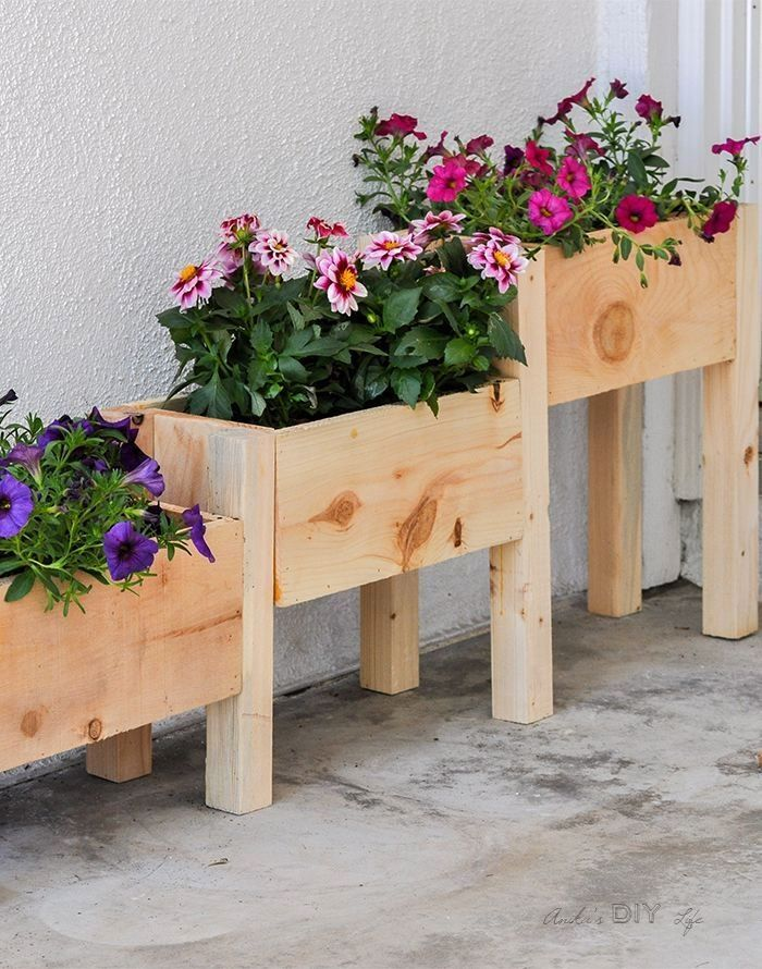 A DIY Cedar Tiered Planter - perfect beginner woodworking project! Can be built with only $10 in Lumber and under 2 hours. They add the perfect touch to your outdoor decor. #WoodworkProjects