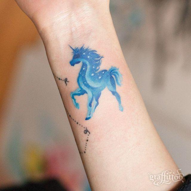 blue unicorn small tattoo