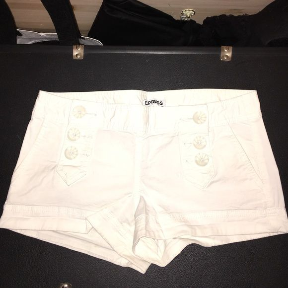 White nautical shorts Cotton shorts with 6 white buttons on the front. Flap pockets on the back. Gently worn. Express Shorts