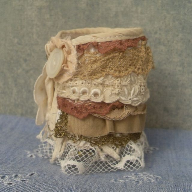 ruffled wrist cuff from salvaged textiles by Resurrection Rags, via Flickr