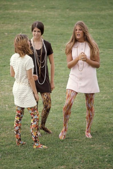 1969 -The mini dresses and long, layered necklaces are cute, but those patterned tights are straight fire.
