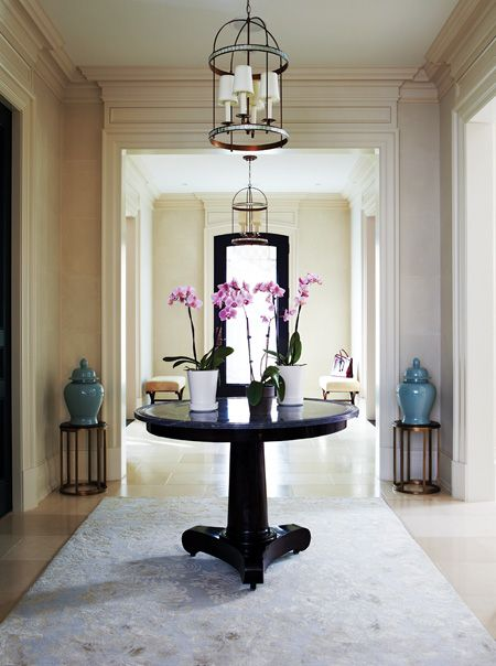Brian Gluckstien knows how to make an entrance! This Toronto home is the epitome of classical symmetry with the cream architraves above the archways and traditional crown lining the ceiling. #trim #interiorfinishings #enterance #inspiration #moulding